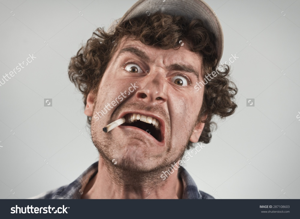stock-photo-angry-redneck-yells-and-shouts-while-smoking-a-cigarette-287108603[662229].jpg