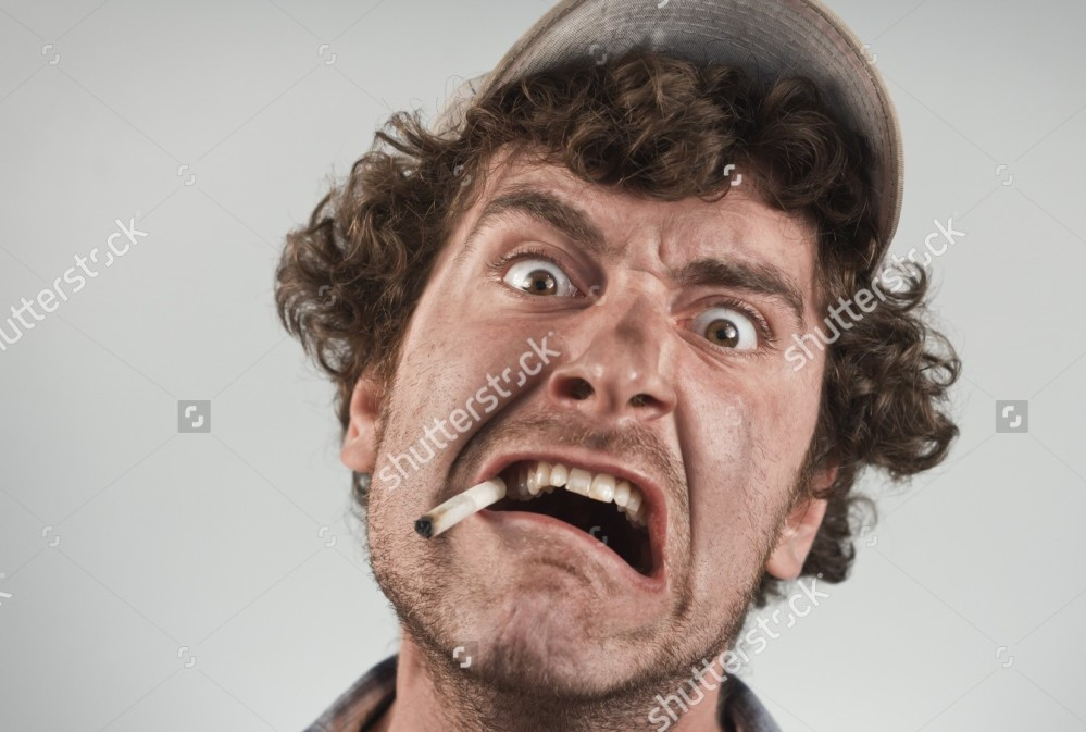 stock-photo-angry-redneck-yells-and-shouts-while-smoking-a-cigarette-287108603[664].jpg