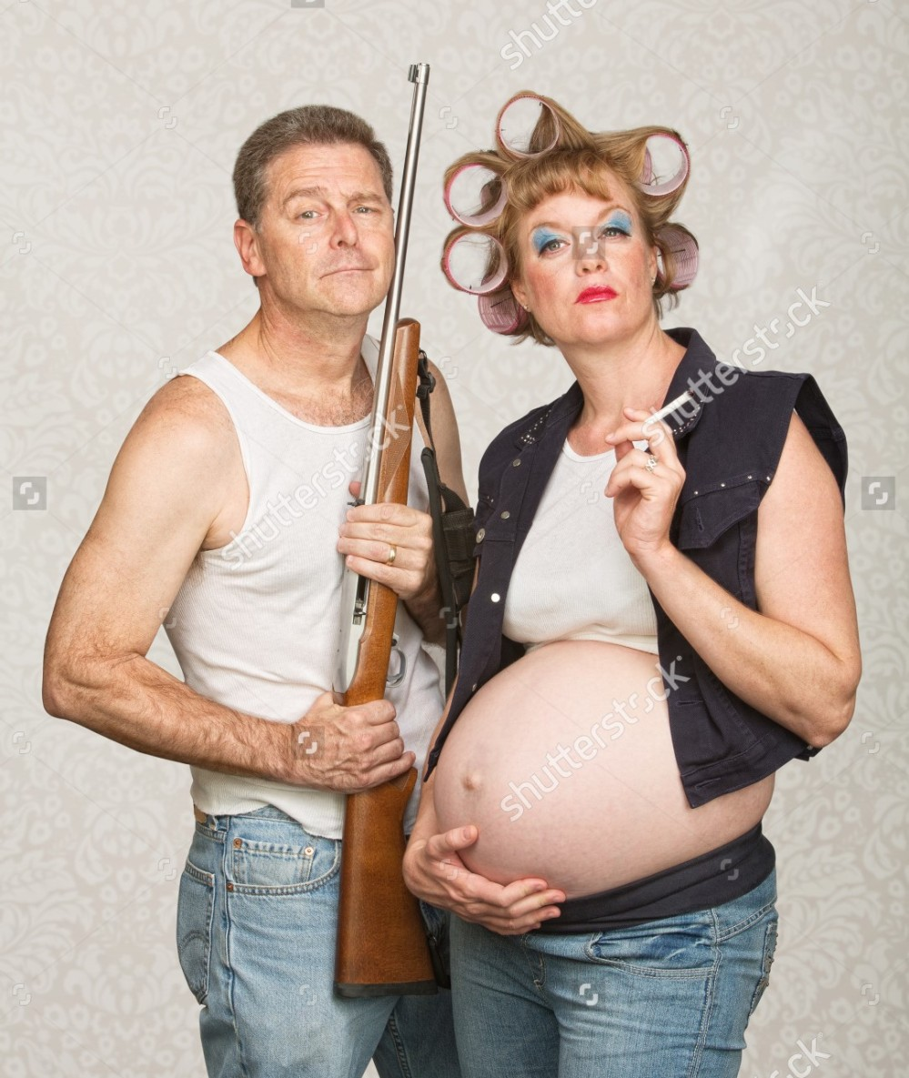 stock-photo-negligent-pregnant-hillbilly-couple-with-rifle-and-cigarettes-162477740[730].jpg