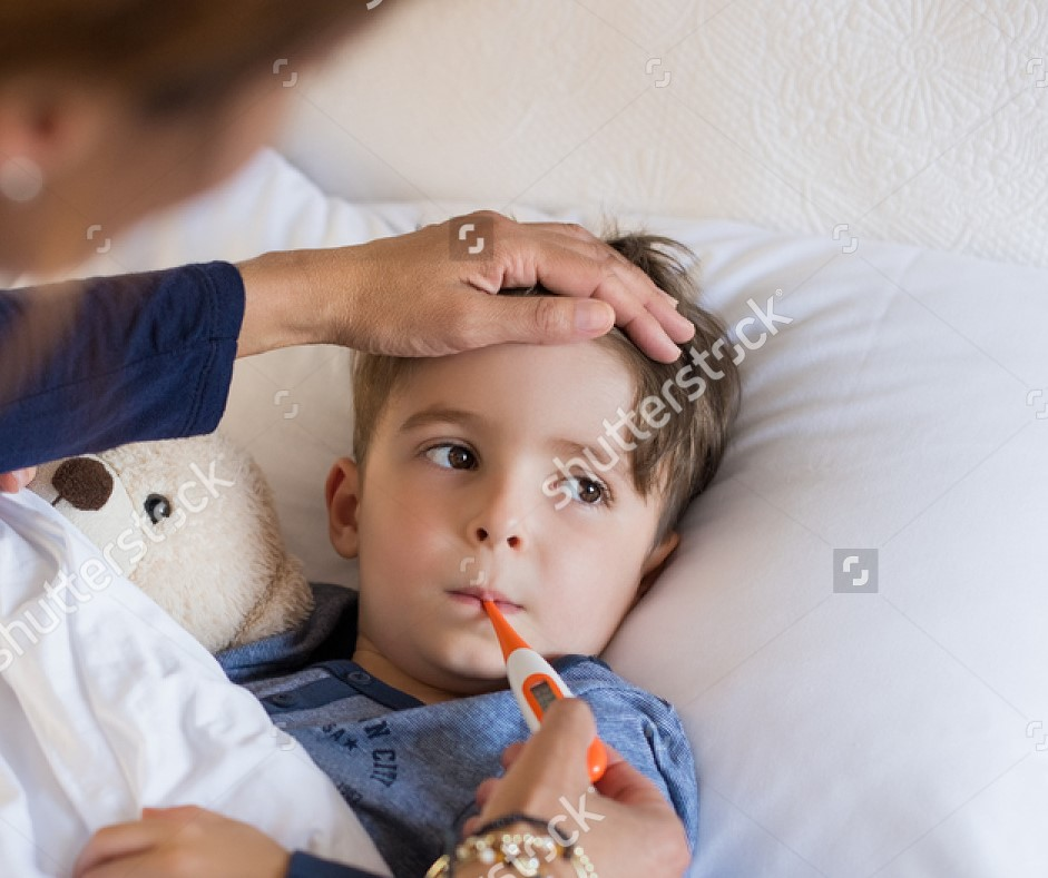 stock-photo-sick-boy-with-thermometer-laying-in-bed-and-mother-hand-taking-temperature-mother-checking-450568075[983].jpg