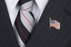 politican-wearing-lapel-pin-politician-american-flag-lapen-s[2458].jpg